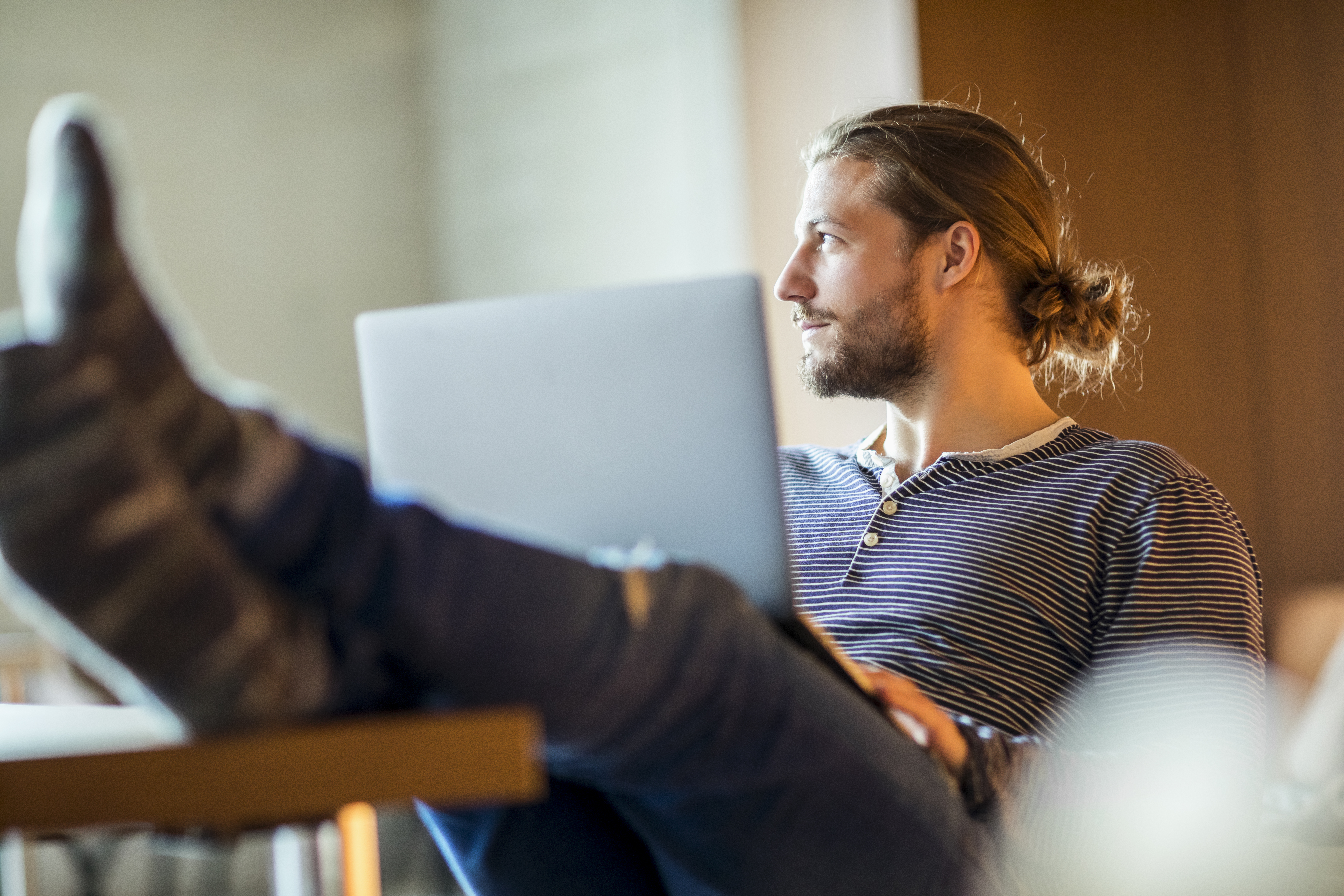 Man working from home (WFH) using Poly products